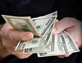 Hands with dollars — Stock Photo