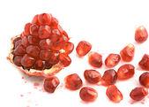 Open pomegranate and arils — Stock Photo