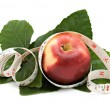 An apple with measuring tape — Stock Photo