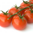 Closeup of branch of cherry tomatoes — Stock Photo #1899262