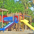 A colorful public playground in a garden — Stock Photo #1904125