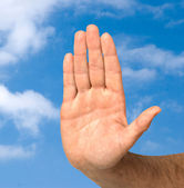 Hand protecting clean sky — Stock Photo