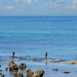 Fishers at low tide of Mediterranean — Stock Photo