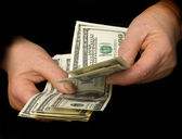 Hands counting dollars — Stock Photo