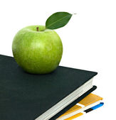 Apple on top of books — Stock Photo
