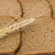 Wheat ear layng on slices of bread — Stock Photo