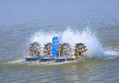 Paddlewheeler aerators in aquaculture — Stock Photo