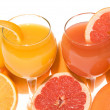 Fresh grapefruit and orange juice — Stock Photo