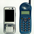 Old and new mobile telephone - Stock Photo