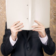 Businessman holds a folder - Stock Photo