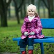 Royalty-Free Stock Photo: Girl sits on bench