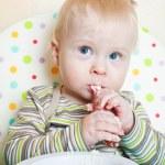 Little boyl eats porridge — Stock Photo #1895888