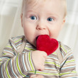 Funny boy with heart in mouth — Stock Photo #1896512