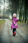 Little girl running — Stock Photo
