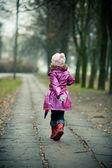 Little girl running — Stock Photo