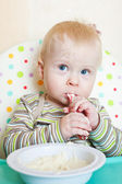 Little boyl eats porridge — Stock Photo