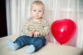 Funny boy with heart balloon — Stock Photo
