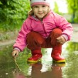 Girl plays in puddle — Stock Photo #1951154