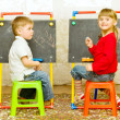 Girl and boy drawing on the blackboard — Stok fotoğraf