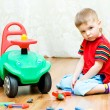 Royalty-Free Stock Photo: Little boy can\'t repair auto