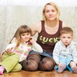 Foto Stock: Mother with son and daughter on a floor