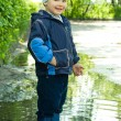 Little boy in puddle — Stock Photo #1951316