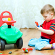Little boy repairs auto — Stock Photo