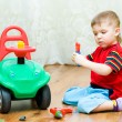 Stock Photo: Little boy repairs auto