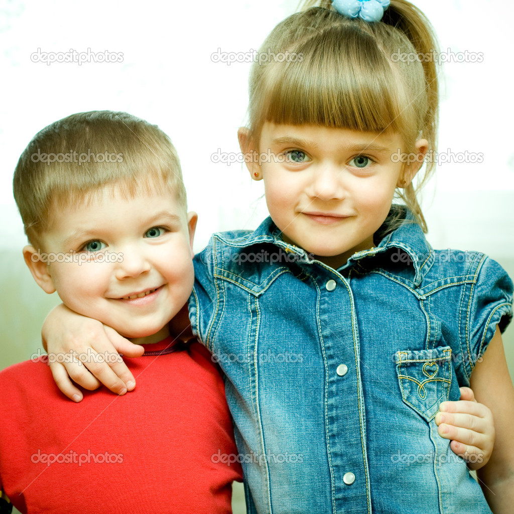 Two siblings embrace each other and laughing happily.  Stock Photo #1951197