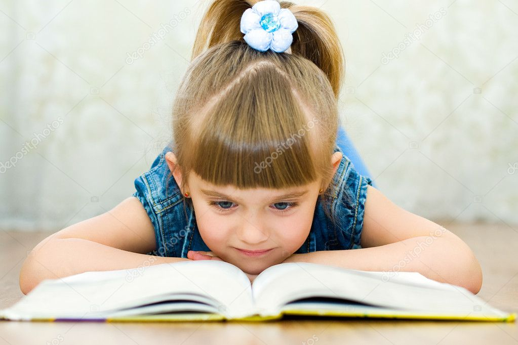 Girl reads book  Stock Photo #1951355