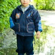 Little boy in puddle — Stock Photo #1978075