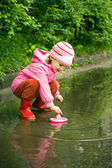 Little girl playing in the puddle — Stock Photo