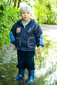 Little boy in the puddle — Stock Photo