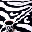 Stock Photo: Zebrcup on zebrcarpet