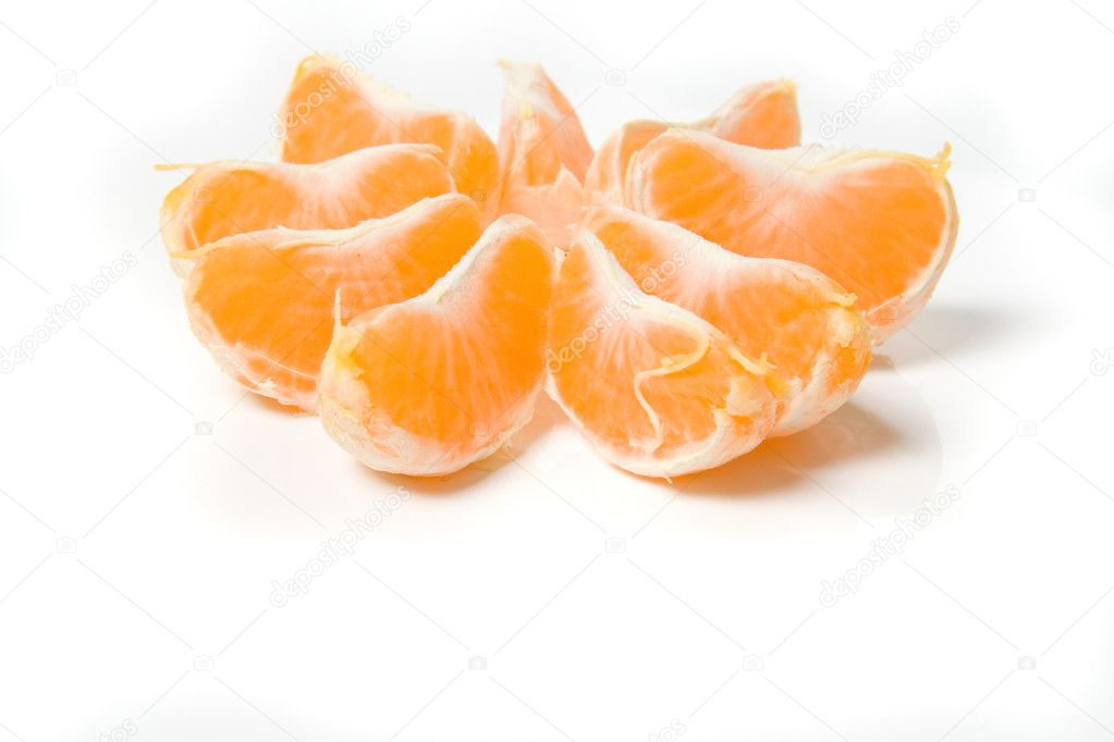 Segments of fresh tangerine fruit isolated on white background  Stock Photo #1876844