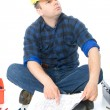 Handyman with blueprint - Stock Photo