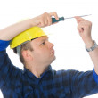 Worker and screwdriver - Stock Photo