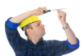 Worker and screwdriver — Stock Photo