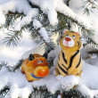 Statuettes bull and tiger on  fir — Stock Photo