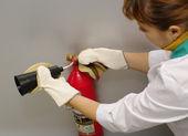 Extinguisher in hands of operator — Stock Photo