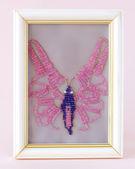 Handiwork.Wicker in beads butterfly — Stock Photo