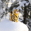 Royalty-Free Stock Photo: Statuette tiger on snow-bound stub