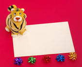 Tiger statuette and blank on red — Stock Photo