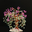 Stock Photo: Wicker in beads.blooming sakura.