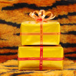 Present boxes on tiger pattern — Stock Photo