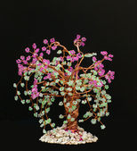 Wicker in beads.blooming sakura. — Stock Photo