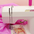 Stock Photo: Money on sewing-machine