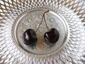 Cherry on dish — Stockfoto