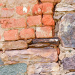 Rock wall fixed with bricks — Stock Photo