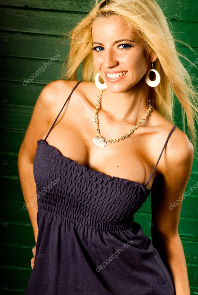 depositphotos 2399624 Sexy blonde woman fashion model A vivacious sexy young blonde woman in hat and sunglasses relaxes with her ...